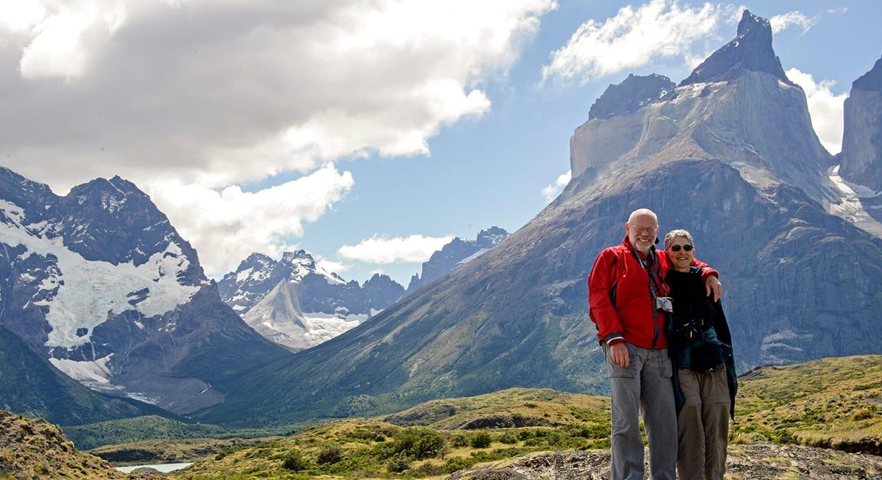 2 slide hikers los glacieres national park pano