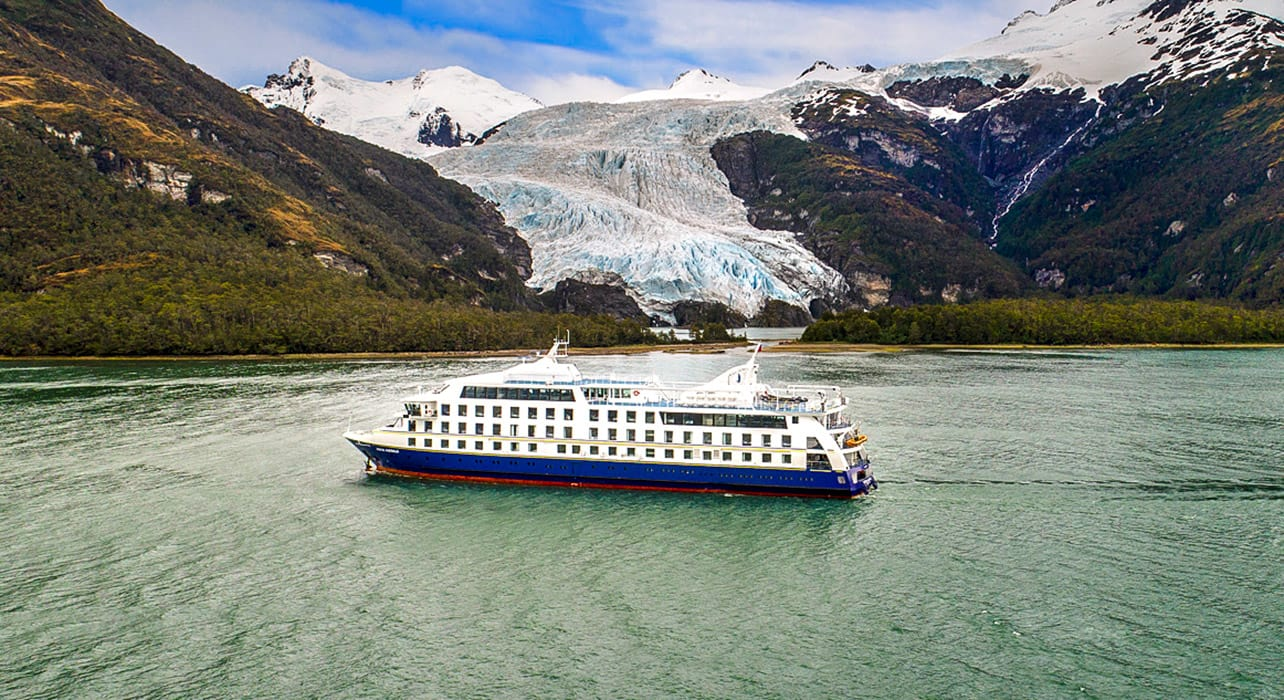 australis ventus cruise ship by glacier