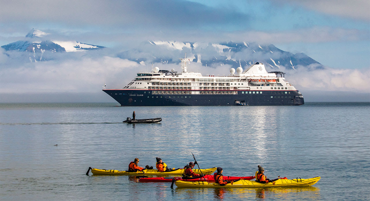 svalbard norway kayaking near cruise ship arctic