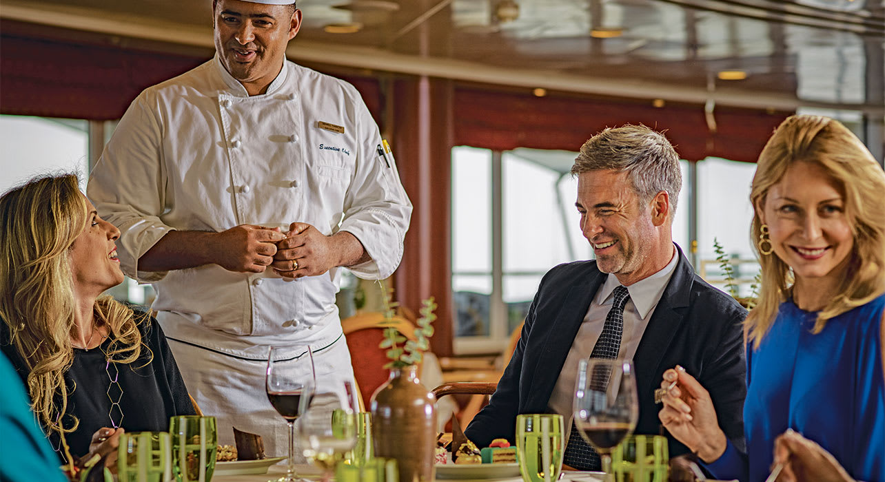 enjoying dinner onbaord the ship with chef