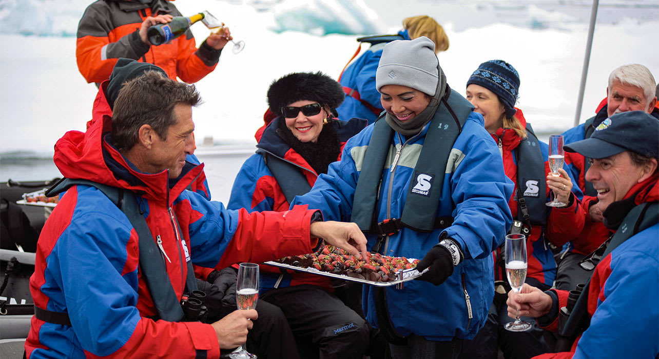 norway svalbard guests enjoying champagne on zodiac arctic