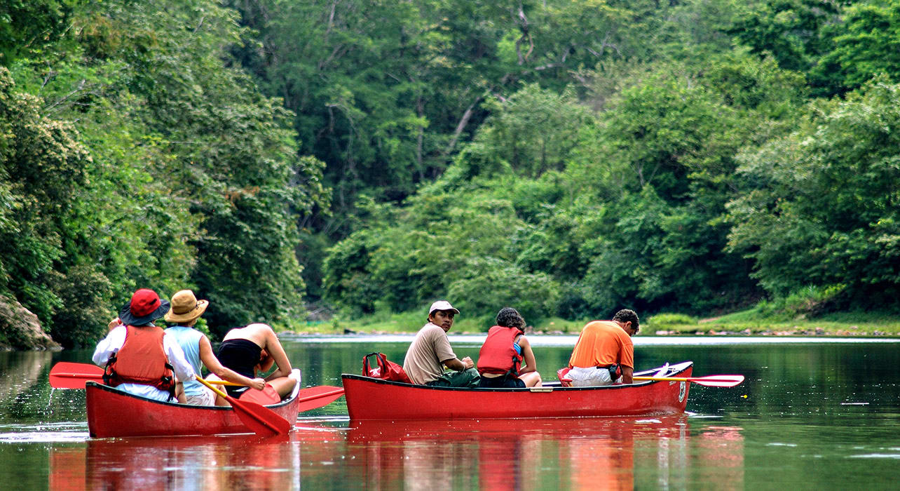 chaa creek canoes on river belize