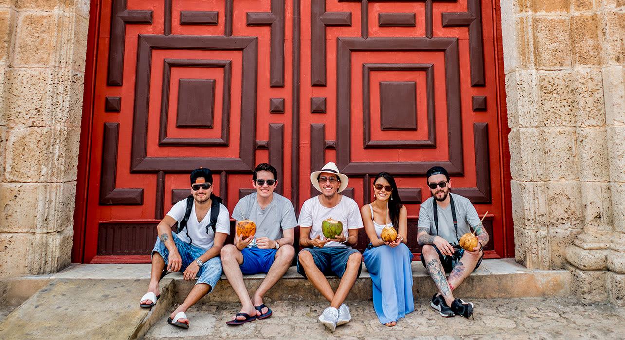 tourists in cartagena in front of door