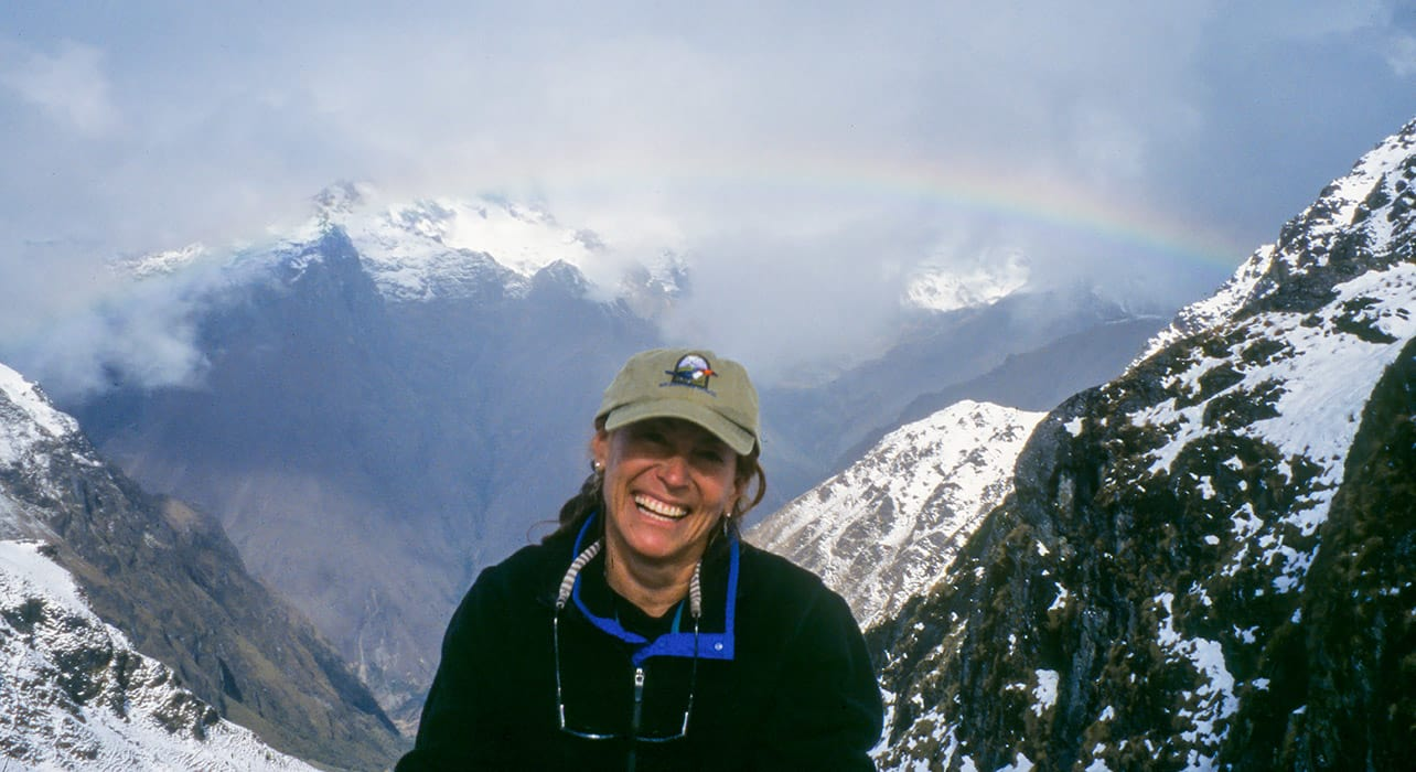 cordillera huayhuash hiker rainbow mountains
