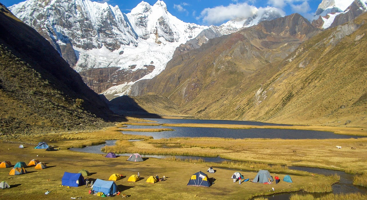cordillera huayhuash campsite at lake
