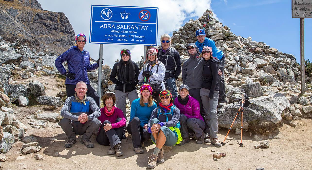 5 slide hikers at the salkantay pass pano
