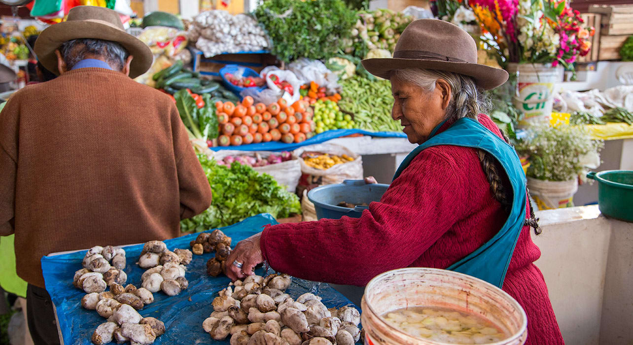market peruvian woman with potatoes