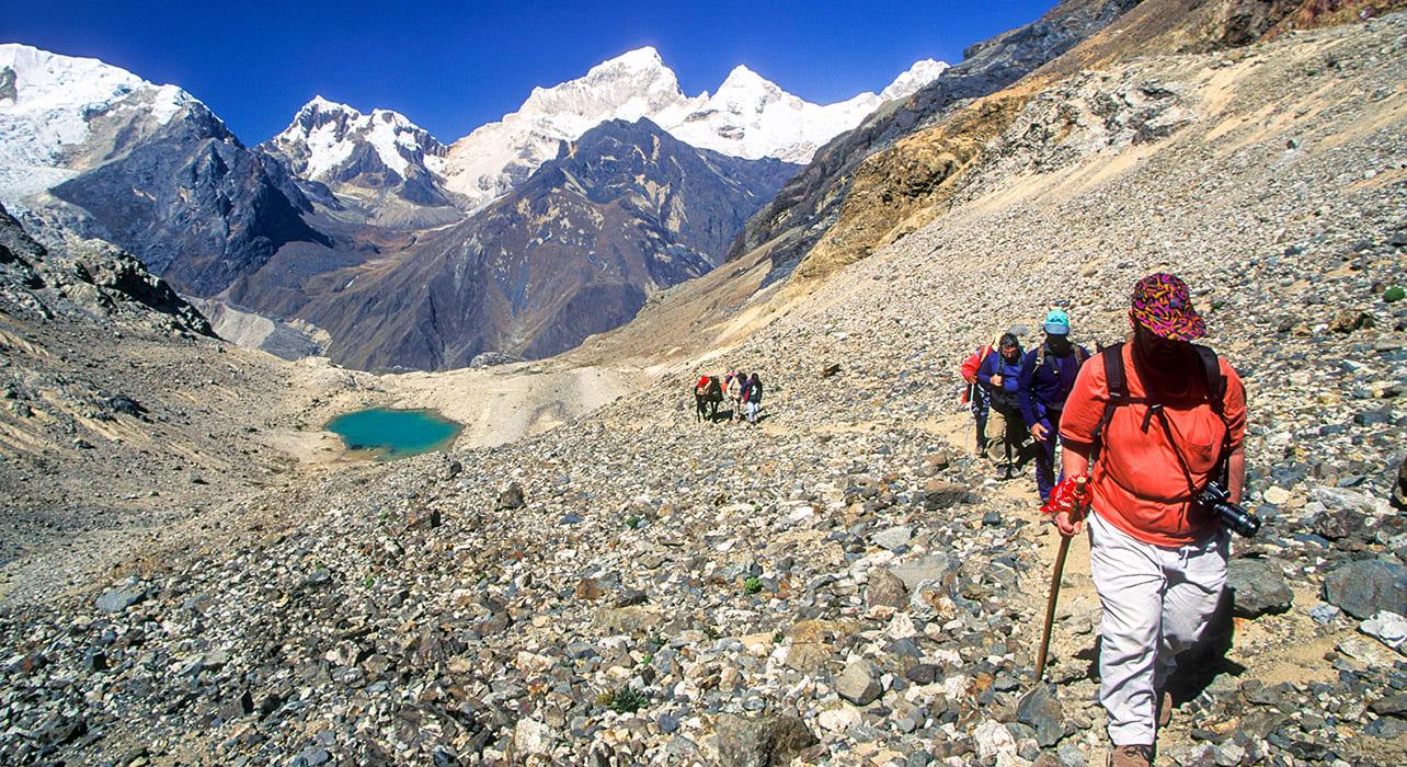 cordillera blanca hikers glacial lake