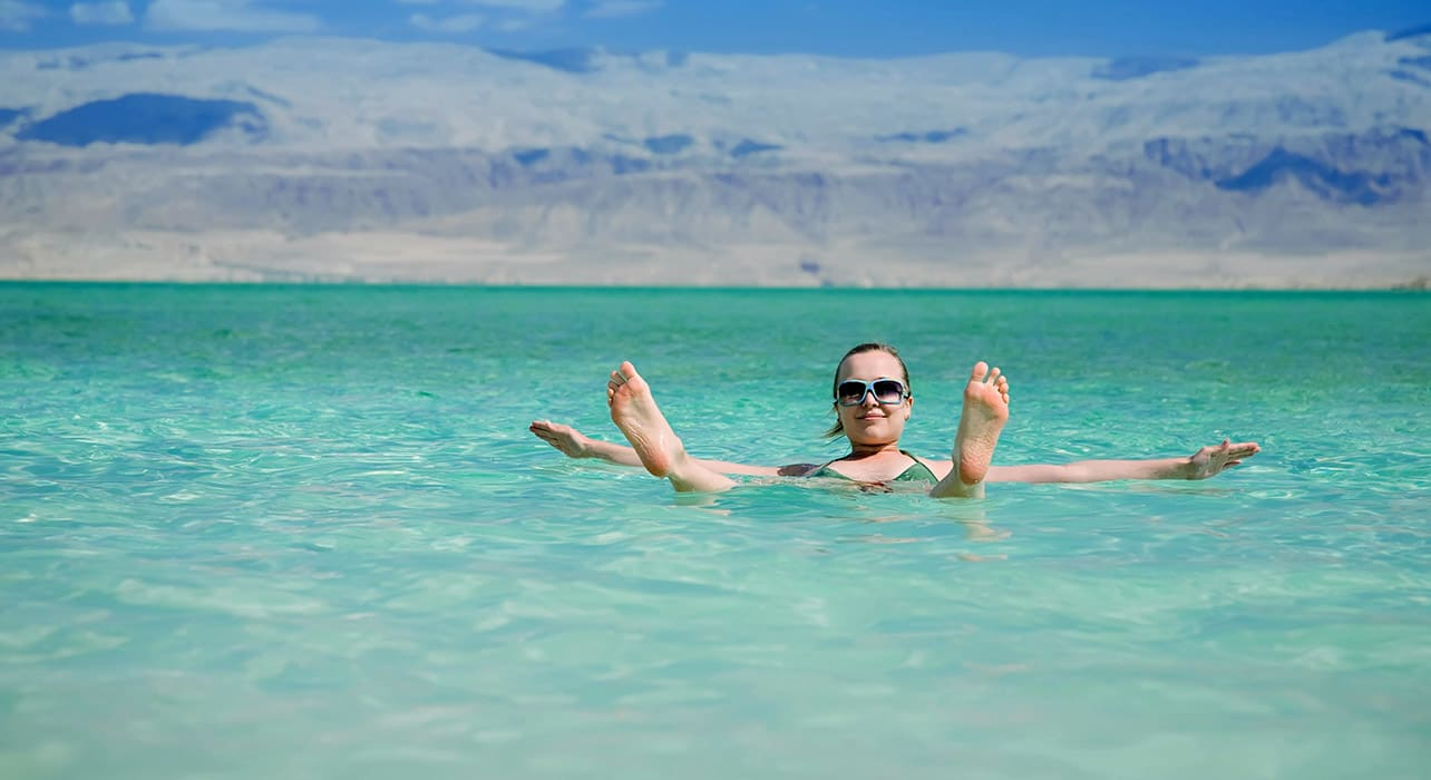 7 slide jordan dead sea swimming floating pano