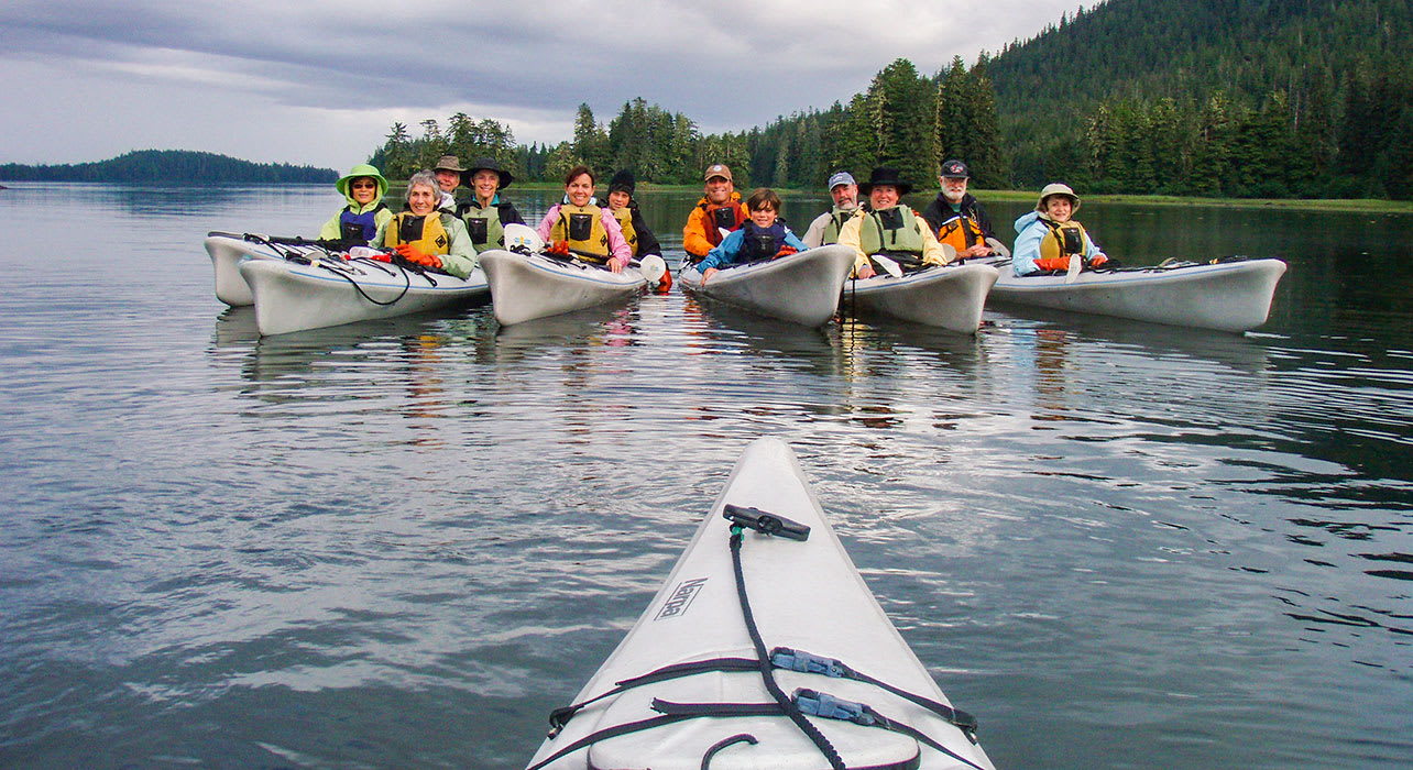 3 slide alaska group of kayakers family pano