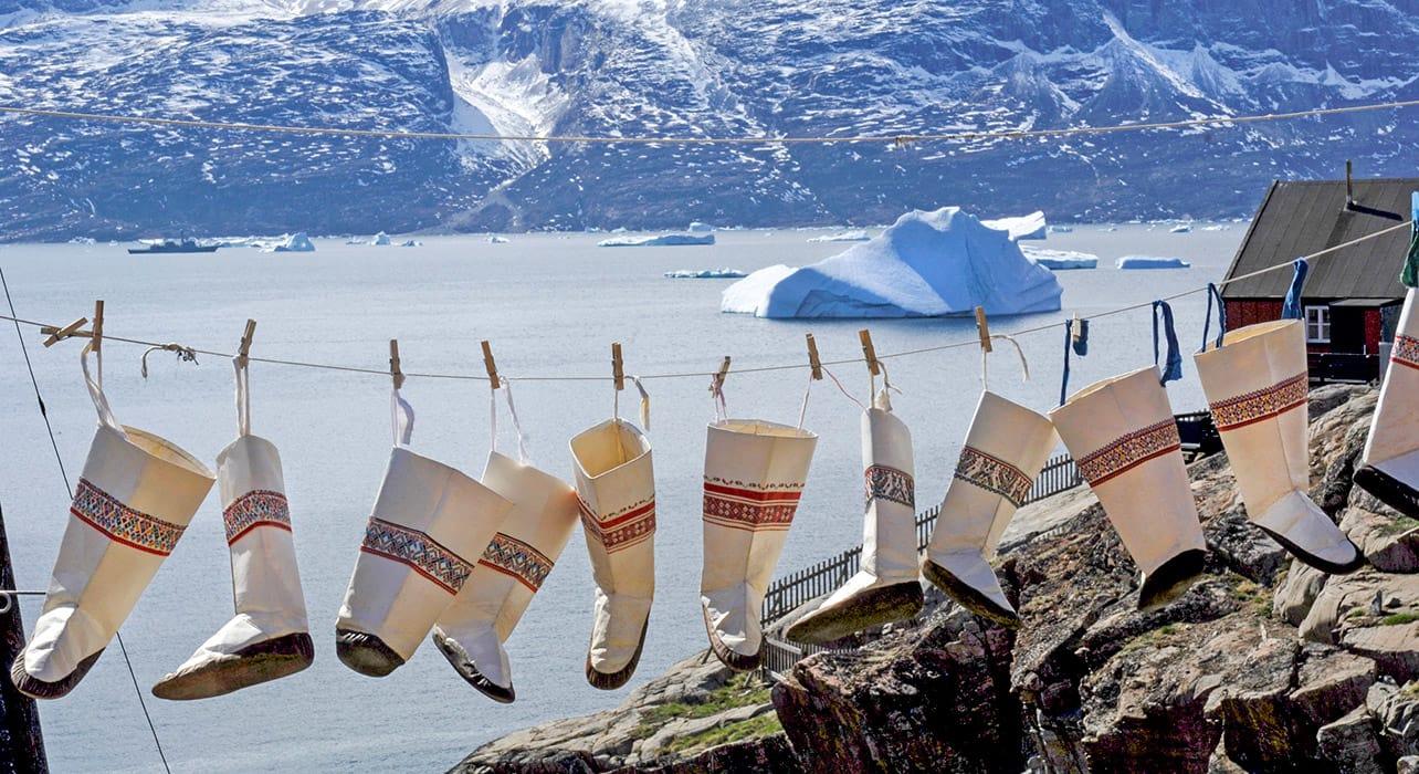 3 slide boot inuit uummannaq greenland pano