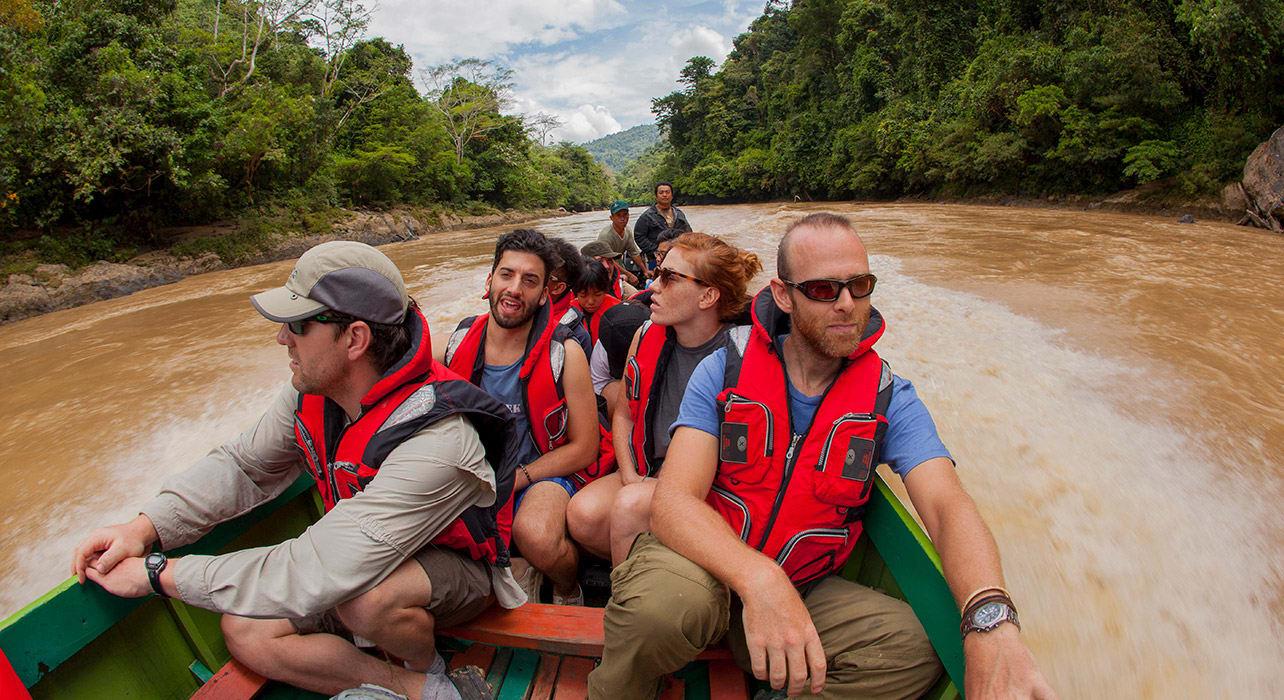 borneo river boat travelers