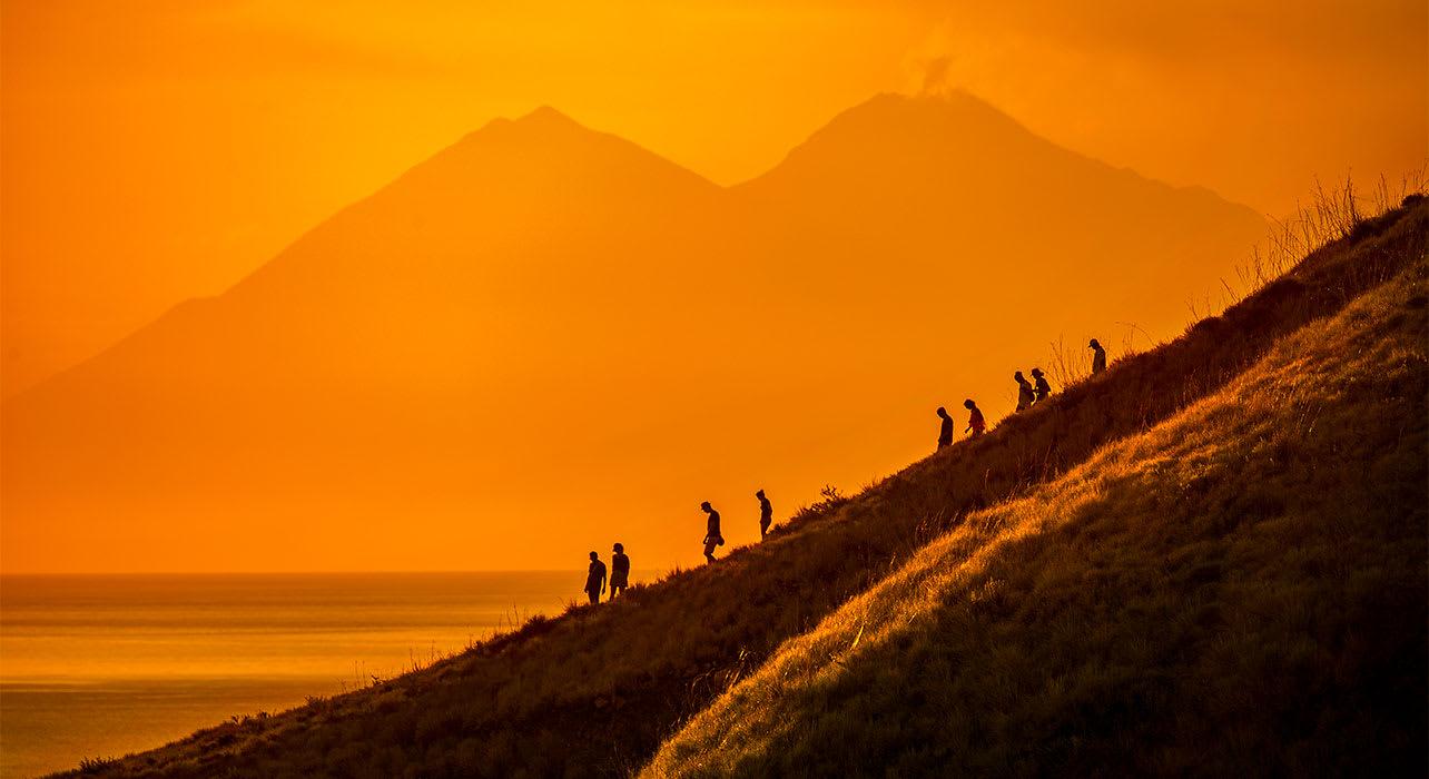 indonesia hiking on komodo island sunset