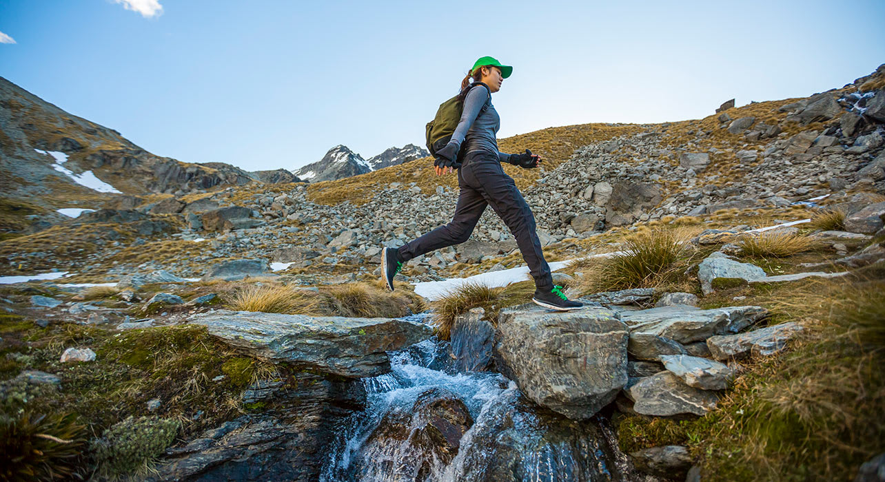 new zealand woman hiker stream