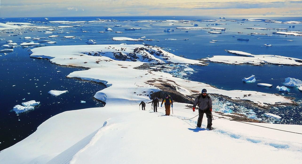 antarctica mountaineering hikers climbing