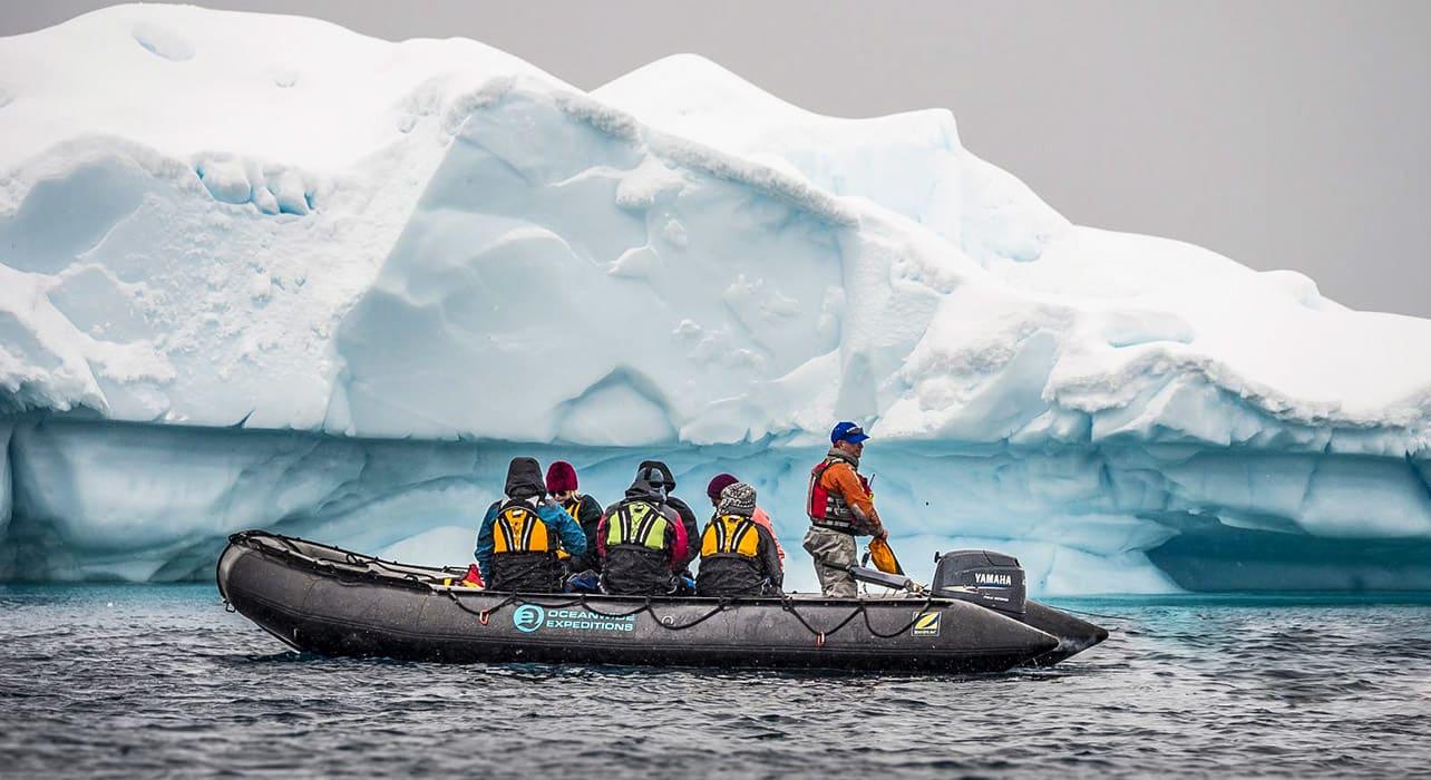 antarctica zodiac boat by iceberg
