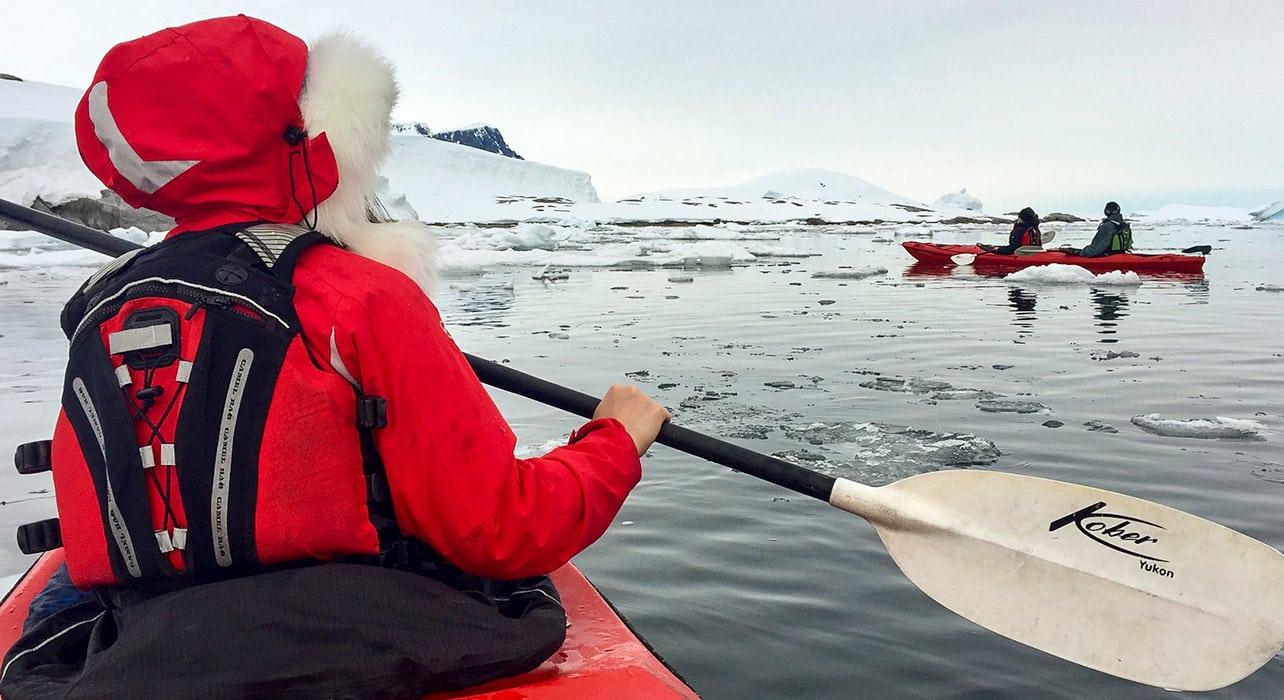 antarctica kayakers icebergs heavy coats