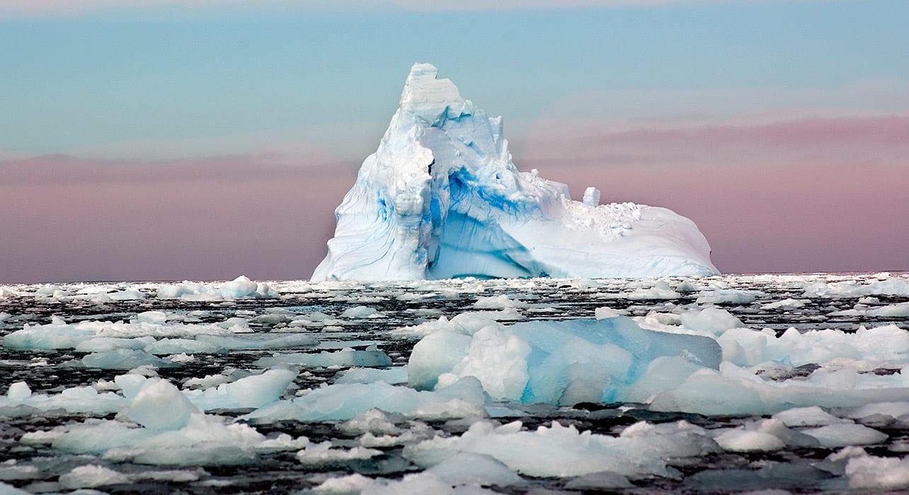 6 slide iceberg antarctica dusk pano