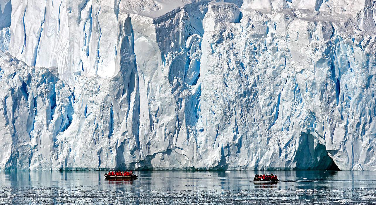 antarctica small boat iceberg