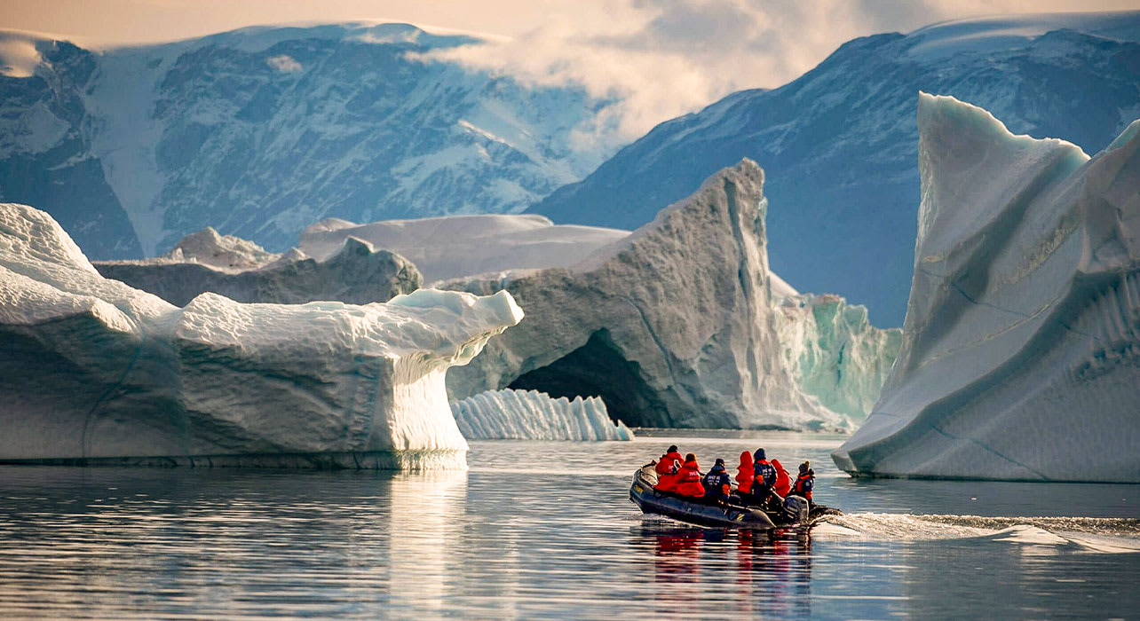 antarctica clients in zodiac by icebergs