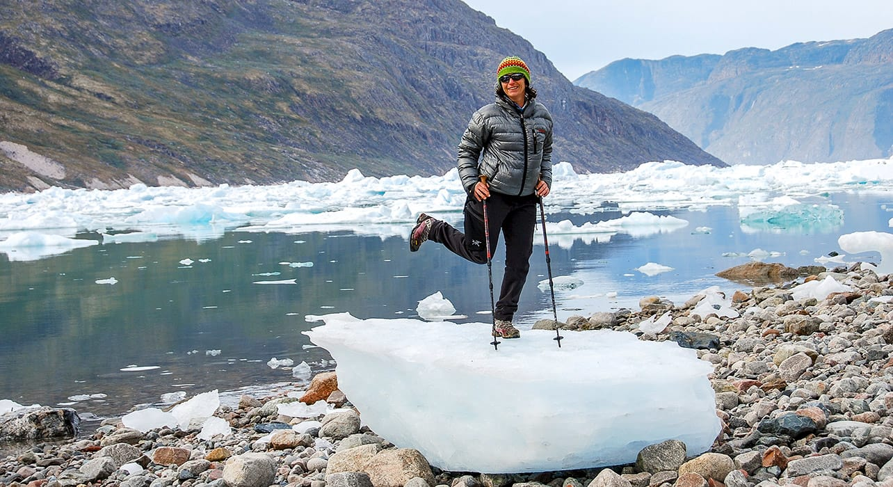 greenland woman standing on ice chunk