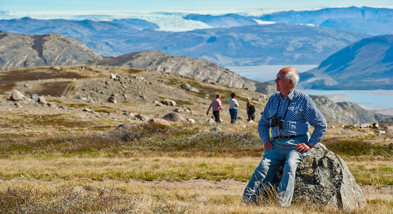 6 slide greenland man resting on rock pano