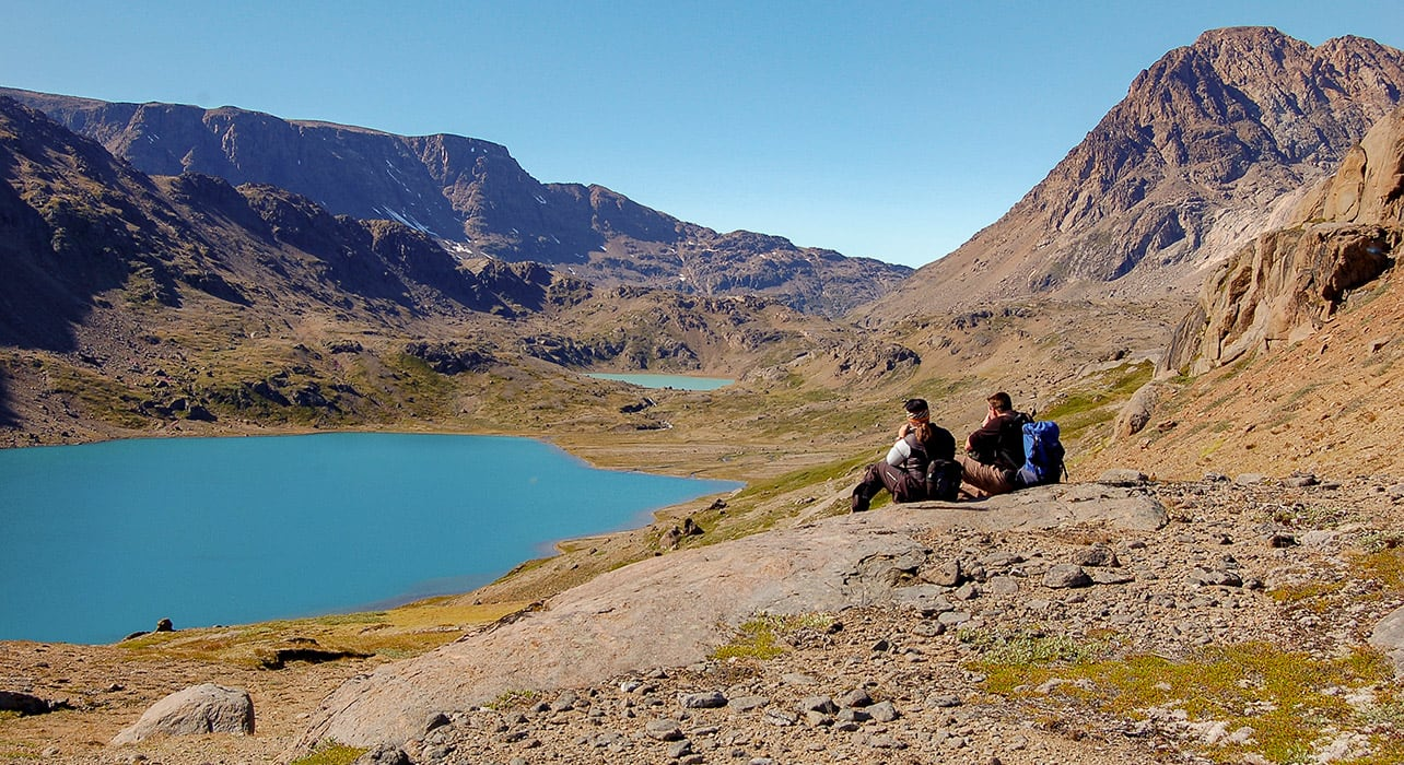 greenland hikers enjoying lake view