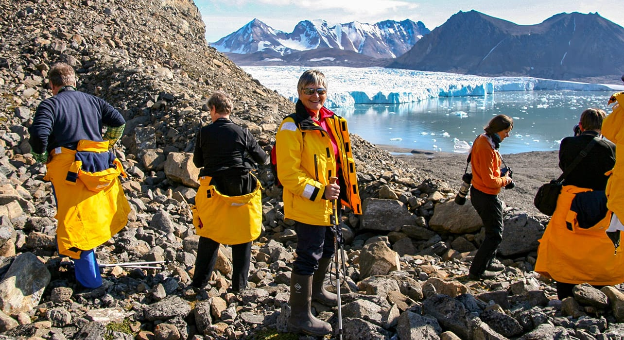 greenland hikers viewing glacier