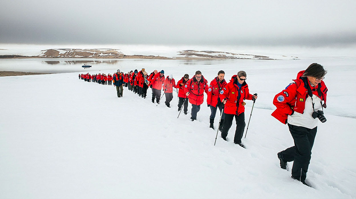arctic west spitsbergen polar ice tourists hiking in snow