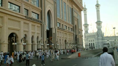 Hotel Royal Dar Al Eiman front side with people walking in front of it