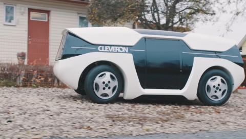 Dieses selbstfahrende Auto liefert Pakete mit einem Roboterarm aus