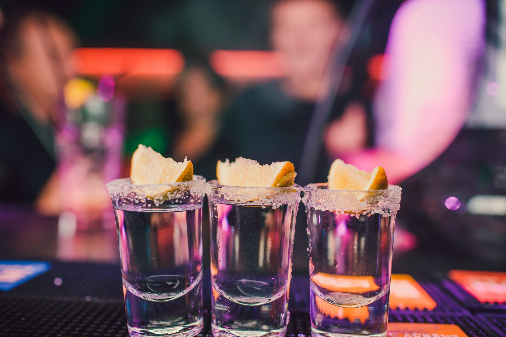 shot glasses, bar, people, lemons, top selling vodka, 2019, wisk ai