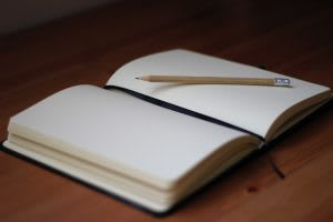 notebook, pencil, table