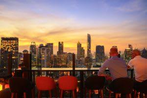 rooftop bar, men, sunset, city