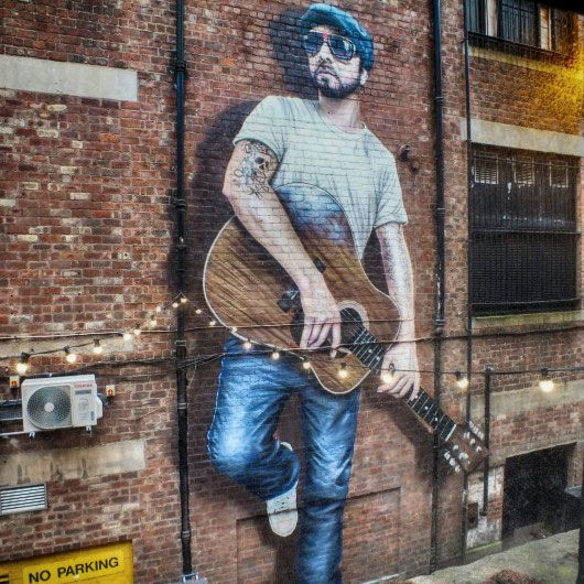 """""""The Musician"""" by Rogue, in Sauchiehall Lane"""