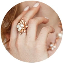 Women hand with pearl ring