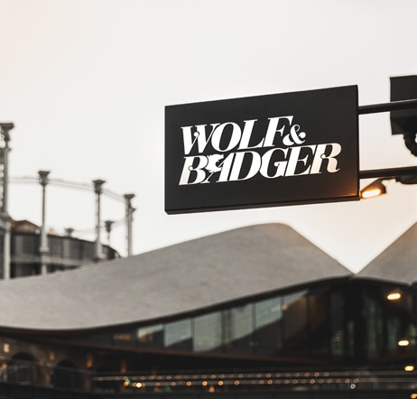 Wolf and Badger store poster and coal drops yard in the background