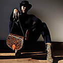 Leopard Print Leather Saddle Bag In Tan With Back Pocket image