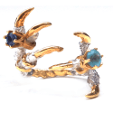 Pigeon Grasp Claws with Blue Sapphire Rings image