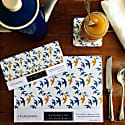 Set of 4 Flock Coasters - Blue & Ochre Swallow Print on White image