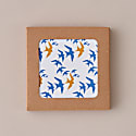 Set Of 4 Flock Coasters - Blue & Ochre Swallow Print On White image
