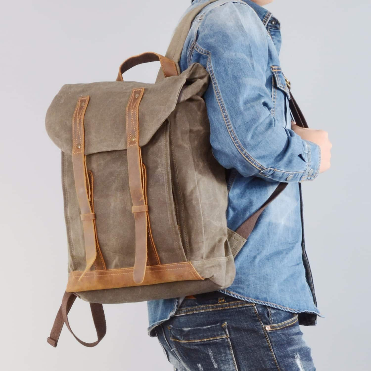ccf16686b Leather Straps Waxed Canvas Backpack Green | EAZO | Wolf & Badger