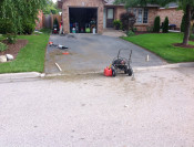 We start by prepping and cleaning the ashpalt driveway to be resealed including filling cracks