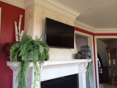 "42"" TV Mounted above a Fireplace"