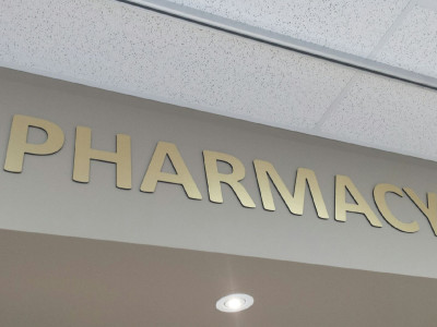 Brushed gold aluminum laminate pharmacy sign