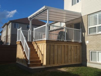 Pressure Treated deck with a Natural light patio cover and railing