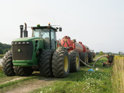 John Deere 9000 series tractor with  Nuhn quad train 12000 US Gallon capacity.