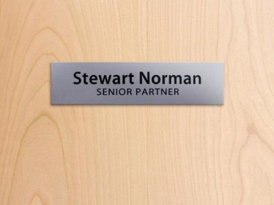 Engraved door signs.
