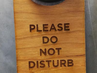 Wooden do not disturb door hanger for hotel rooms.