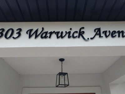 6mm laser cut black acrylic address sign, pin mounted on stucco, Oakville Ontario Canada